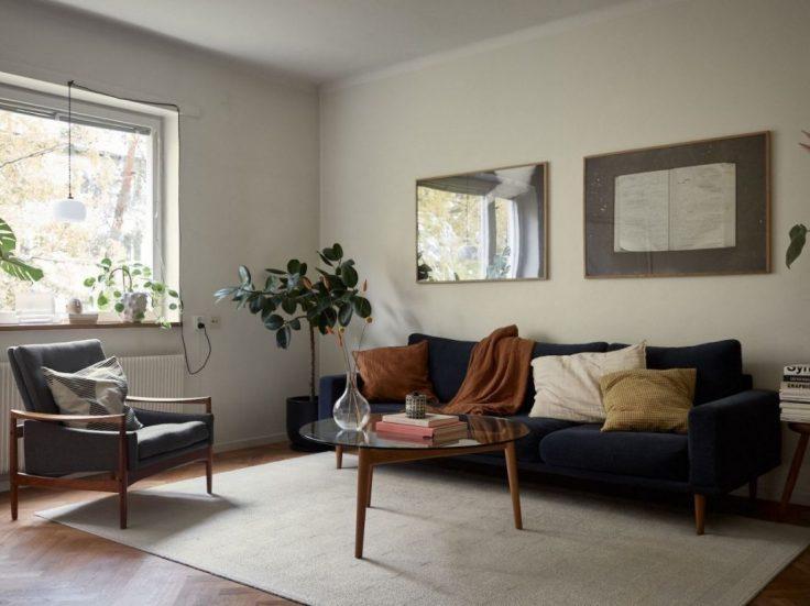 Departamento pequeño nórdico de 51 metros²: sala con buena distribución y muebles escandinavos 6