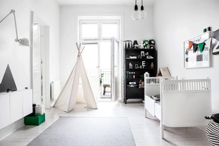 Dormitorio infantil con decoración minimalista en blanco y negro